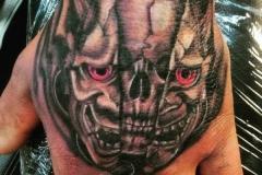 emerging-skull-tattoo